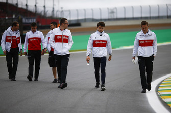 Charles Leclerc, Sauber, walks the circuit with colleagues