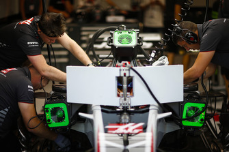 Engineers work on the car of Romain Grosjean, Haas F1 Team VF-18