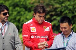 Luis Garcia Abad, with Fernando Alonso, Ferrari signs autographs