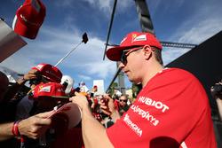 Kimi Raikkonen, Ferrari signs autographs for the fans at the autograph session