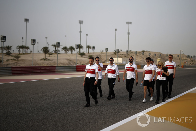 Charles Leclerc, Sauber and Ruth Buscombe, Sauber Race Strategist walk the track