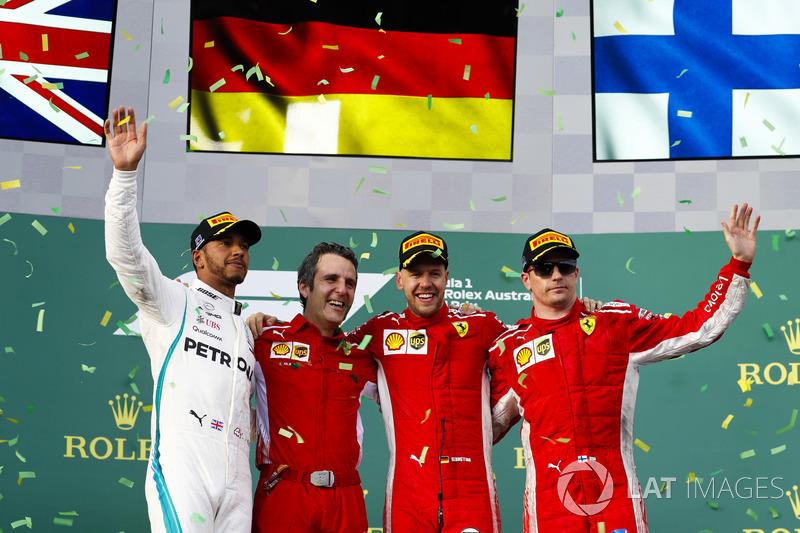 Lewis Hamilton, Mercedes AMG F1, 2nd position, Inaki Rueda, Race Strategist, Ferrari, Sebastian Vettel, Ferrari, 1st position, and Kimi Raikkonen, Ferrari, 3rd position, on the podium