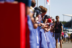 Romain Grosjean, Haas F1 Team, signs autographs for fans