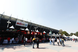 Fans walk by merchandising stands ahead of the race