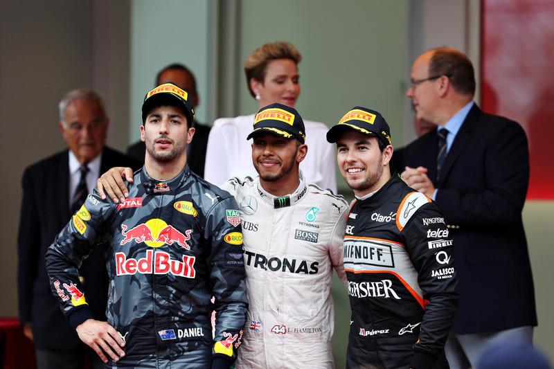 Top three finishers, Lewis Hamilton, Mercedes AMG F1, Daniel Ricciardo, Red Bull Racing and Sergio Perez, Force India on the podium