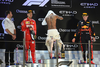 (L to R): Bradley Lord, Head of Mercedes-Benz Motorsport Communications, Sebastian Vettel, Ferrari, Lewis Hamilton, Mercedes AMG F1 and Max Verstappen, Red Bull Racing celebrate on the podium with the Rose Water