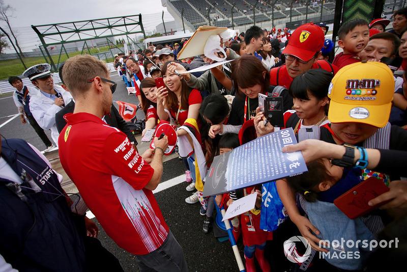 Sebastian Vettel, Ferrari signs autographs for fans