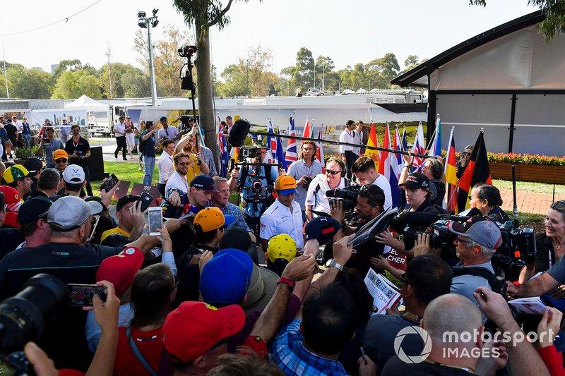 Lando Norris, McLaren, and Carlos Sainz Jr., McLaren, signs autographs for fans