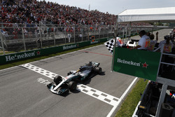 Lewis Hamilton, Mercedes AMG F1 W08, takes the chequered flag at the finish to win the Canadian GP