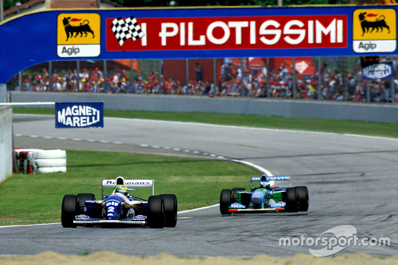 Ayrton Senna, Williams FW16, leads Michael Schumacher, Benetton B194