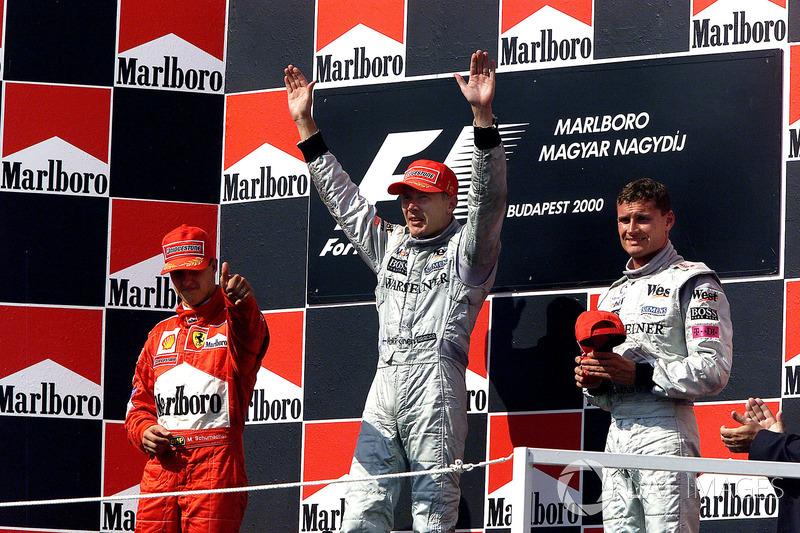 Podium: 1. Mika Häkkinen, McLaren; 2. Michael Schumacher, Ferrari; 3. David Coulthard, McLaren