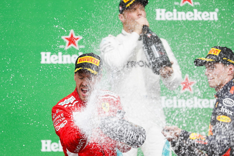 Sebastian Vettel, Ferrari, 1st position, Max Verstappen, Red Bull Racing, 2nd position, and Max Vers