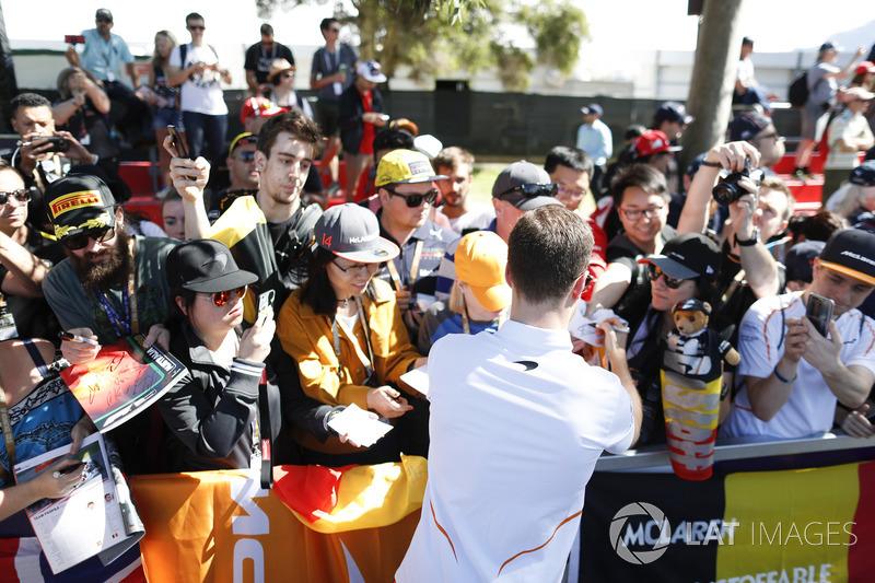 Stoffel Vandoorne, McLaren, signs autographs for fans