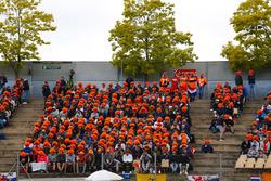 Dutch fans of Max Verstappen, Red Bull Racing RB14, wear orange wigs