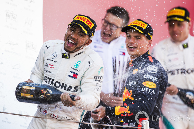 Lewis Hamilton, Mercedes AMG F1, 1st position, Max Verstappen, Red Bull Racing, 3rd position, celebrate with Champagne on the podium