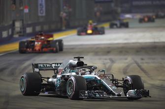 Lewis Hamilton, Mercedes AMG F1 W09 EQ Power+, leads Sebastian Vettel, Ferrari SF71H, and Max Verstappen, Red Bull Racing RB14