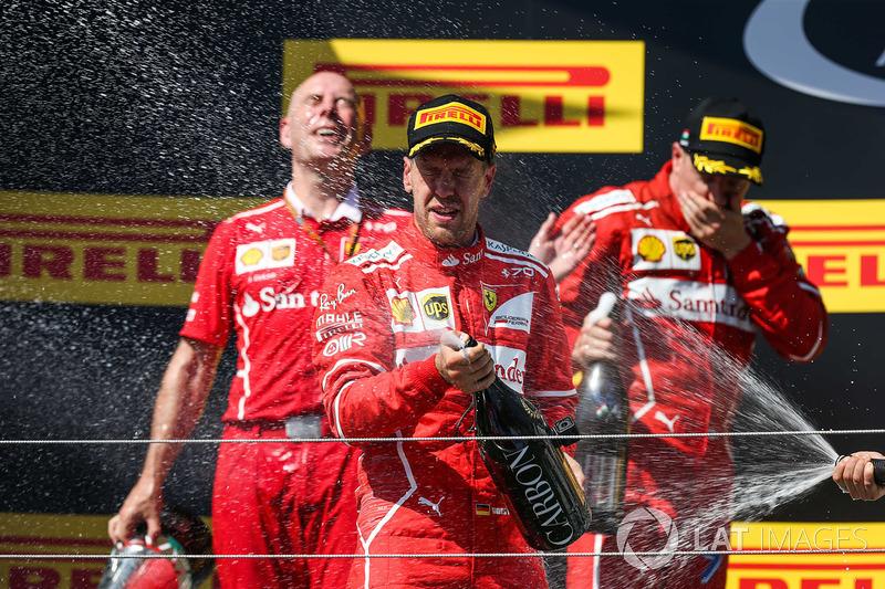 Подіум: переможець Себастьян Феттель, Ferrari, Кімі Райкконен, Ferrari, Валттері Боттас, Mercedes AM