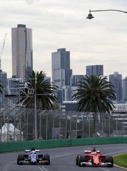 Marcus Ericsson, Sauber C36 and Sebastian Vettel, Ferrari SF70H