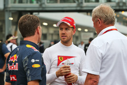 (L to R): Christian Horner, Red Bull Racing Team Principal with Sebastian Vettel, Ferrari and Dr Hel