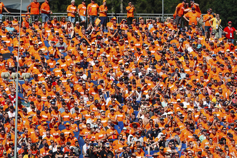 A heavy contingent of Dutch fans in a grandstand