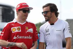 Kimi Raikkonen, Ferrari and Fernando Alonso, McLaren