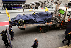 The Red Bull Racing RB13 of Max Verstappen, Red Bull Racing is recovered back to the pits on the back of a truck