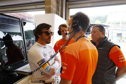 Fernando Alonso, McLaren, talks to his engineer and Zak Brown, Executive Director, McLaren Technology Group