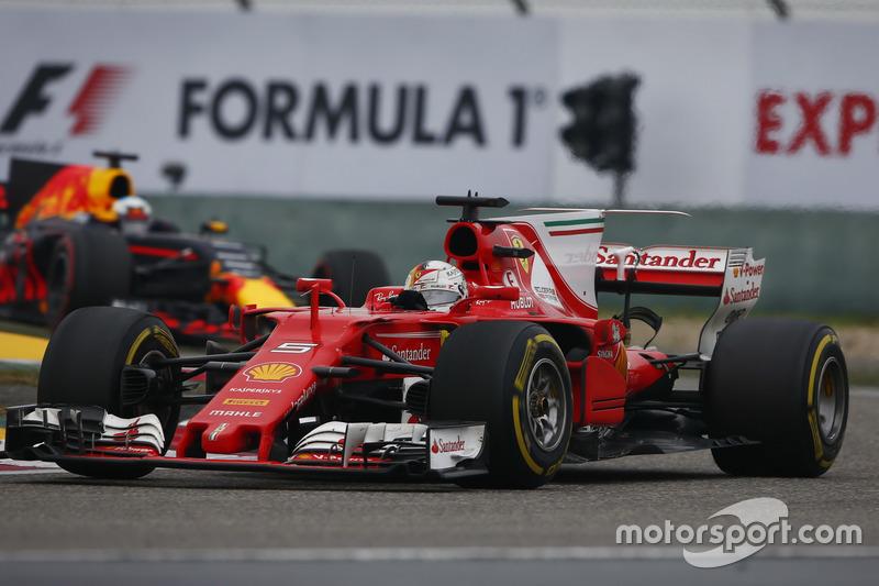 Sebastian Vettel, Ferrari SF70H, leads Daniel Ricciardo, Red Bull Racing RB13