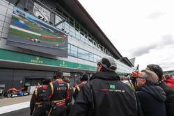 Lotus team members watching the race