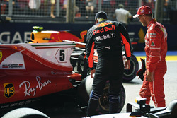 Daniel Ricciardo, Red Bull Racing RB13 and Sebastian Vettel, Ferrari SF70H in parc ferme
