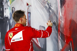 Sebastian Vettel, Ferrari, 1st Position, signs some artwork after winning