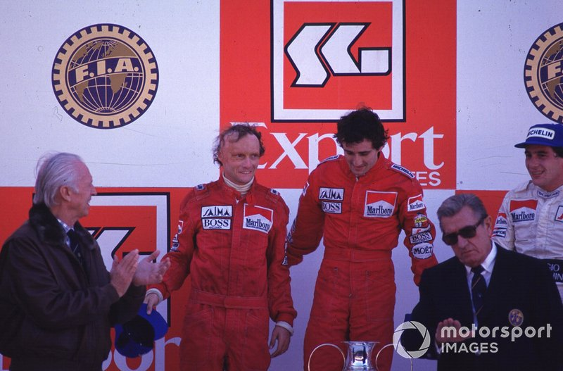 Podium: race winner Alain Prost, second place Niki Lauda, third place Ayrton Senna and Jean-Marie Balestre