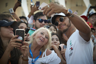 Lewis Hamilton, Mercedes AMG F1, takes a selfie with fan