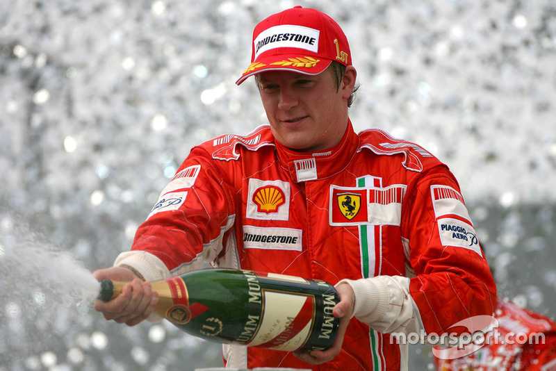 Kimi Raikkonen celebrating his title on the podium at the 2007 Brazilian GP.