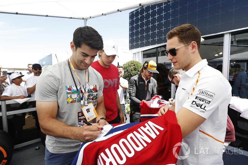 Fernando Alonso, McLaren, and Stoffel Vandoorne, McLaren, swap shirts with hockey players, including