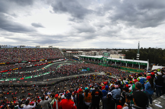 Fans invade the circuit after the race for the podium ceremony