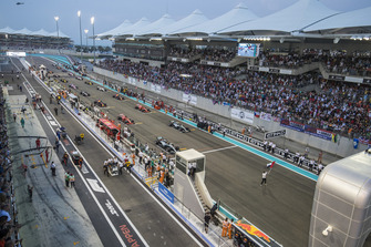 The UAE flag is waved prior to the start of the formation lap