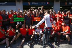 Romain Grosjean, Haas F1 Team, Kevin Magnussen, Haas F1 Team, and the Haas F1 team celebrate the team's best finish to date