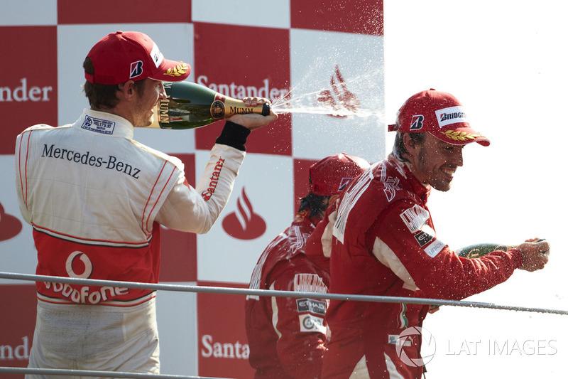 Podium: Jenson Button, McLaren MP4-25 Mercedes, 2nd position, Fernando Alonso, Ferrari F10, 1st position, and Felipe Massa, Ferrari F10, 3rd position