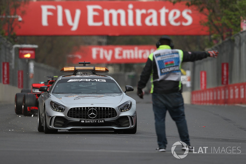 Safety car leads the field and marshal