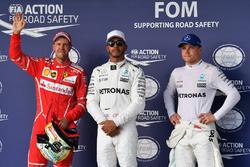 Polesitter Lewis Hamilton, Mercedes AMG F1, second place Sebastian Vettel, Ferrari, third place Valtteri Bottas, Mercedes AMG F1