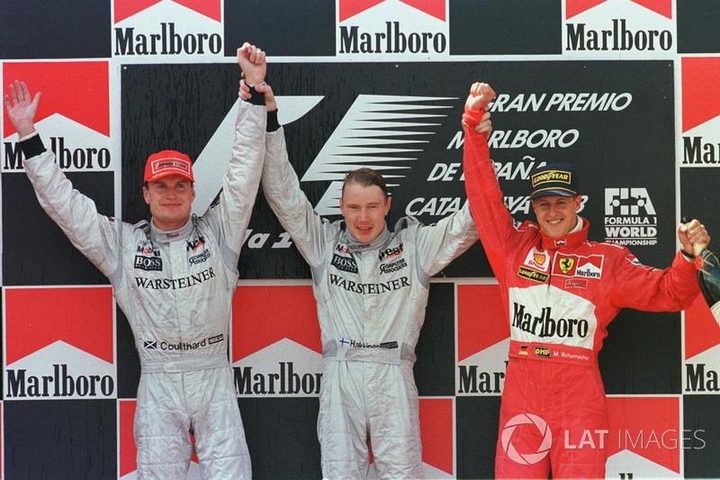 Podium: 1. Mika Häkkinen, 2. David Coulthard, 3. Michael Schumacher