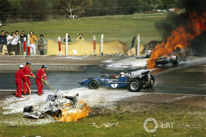 1970 - Jackie Stewart passes the crashed BRM of Jackie Oliver and Ferrari of Jacky Ickx