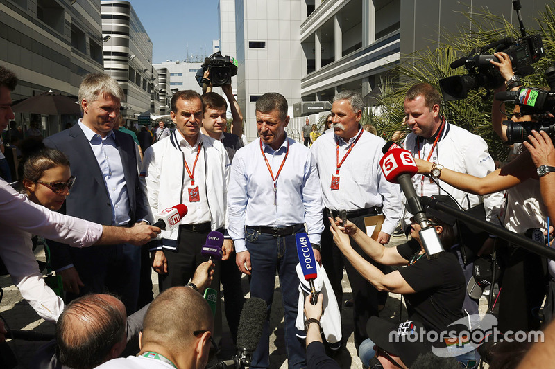 Chase Carey, Chairman, Formula One (second from right), poses, the Russian Vice-President in front of the media