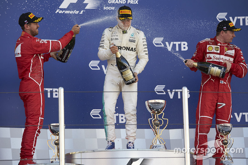 Race winner Valtteri Bottas, Mercedes AMG F1, second place Sebastian Vettel, Ferrari, Third place Ki