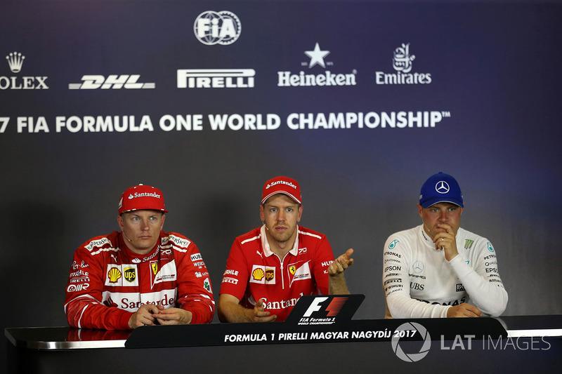Прес-конференція після гонки: переможець гонки Себастьян Феттель, Ferrari, друге місце Кімі Райкконе