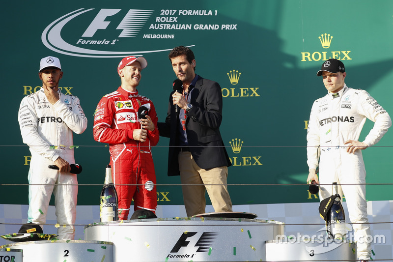 Sebastian Vettel, Ferrari, 1st Position, is interviewed by Mark Webber on the podium