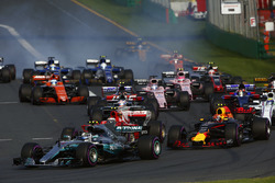 Valtteri Bottas, Mercedes AMG F1 W08, leads Max Verstappen, Red Bull Racing RB13, Kimi Raikkonen, Ferrari SF70H, Felipe Massa, Williams FW40, and the remainder of the field at the start
