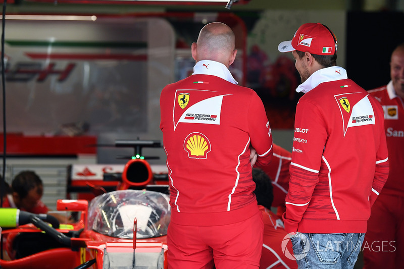 Sebastian Vettel, Ferrari looks at Ferrari SF70H with cockpit shield