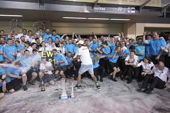 Lewis Hamilton, Mercedes AMG F1, 1st position, celebrates victory in the race, the drivers and the constructors world championships with the Mercedes team